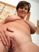Chubby mature shows off her nude forms in solo